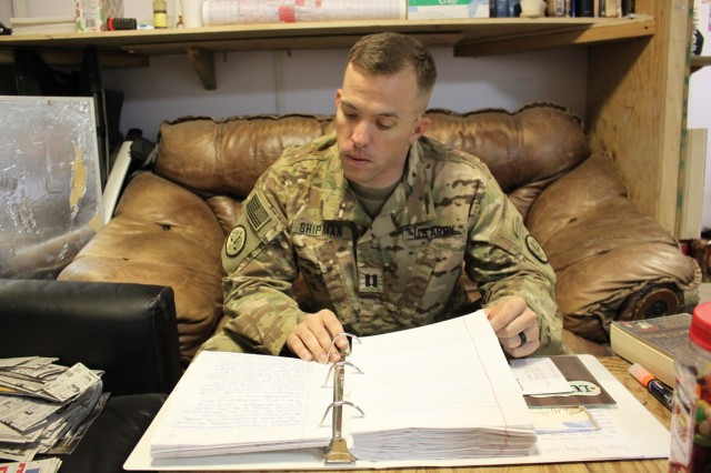U.S. Army Capt. Bryson Shipman browses through hundreds of letters he's received from his grandmother. during his deployment to Tactical Base Gamberi, Afghanistan, October 1, 2016.