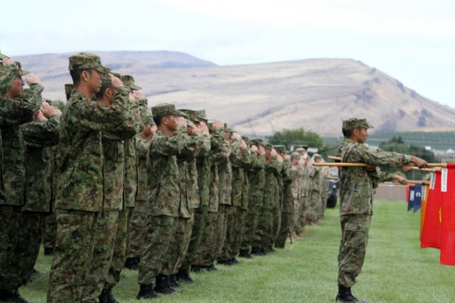 Soldiers from the 2nd Battalion, 1st Infantry Regiment, 2-2 Stryker Brigade Combat Team, 7th Infantry Division, and the 12th Regiment, Japan Ground Self-Defense Force, salute the countries' anthems during the opening ceremony of the 23rd Rising Thunder at Yakima Training Center, Sept. 6, 2016. Rising Thunder is part of Pacific Pathways, which is designed to increase interoperability between partner nations.