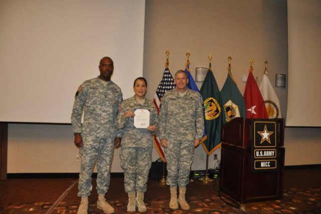Master Sgt. Patricia Font receives a Meritorious Service Medal for her achievements in contracting.