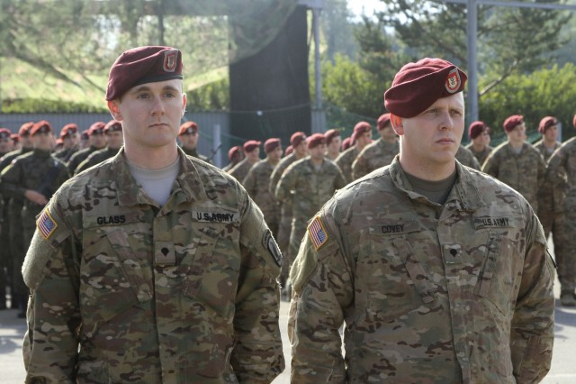 "BIELSKO-BIAŁA, Poland - Spc. Kason Glass, team leader, and Spc. Robert Covey, TOW gunner, assigned to Company D, 2nd Battalion, 503rd Infantry Regiment, 173rd Airborne Brigade, are recognized for their leadership skills during a ceremony hosted by the Polish 18th Airborne Battalion, 6th Airborne Brigade, at their headquarters in Bielsko-Biała, Poland, Oct. 14, 2016. The ceremony was part of an annual celebration and public open house event honoring the history of the 18th Airborne Battalion. The ""Sky Soldiers"" of D Co., 2nd Bn., 503rd Inf. Regt. are in Poland on a training rotation in support of Operation Atlantic Resolve, a U.S. led effort in Eastern Europe that demonstrates U.S. commitment to the collective security of NATO and dedication to enduring peace and stability in the region. The 173rd Airborne Brigade, based in Vicenza, Italy, is the Army Contingency Response Force in Europe, and is capable of projecting forces to conduct a full range of military operations across the United States European, Central and Africa Command areas of responsibility within 18 hours.(U.S. Army photo by Sgt. Lauren Harrah/Released)"