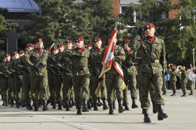 "BIELSKO-BIAŁA, Poland - Polish paratroopers with the 18th Airborne Battalion, 6th Airborne Brigade conduct a pass in review during a ceremony at the battalion headquarters in Bielsko-Biała, Poland, Oct. 14, 2016. The ceremony was part of an annual celebration and public open house event honoring the history of the 18th Airborne Battalion. U.S. paratroopers assigned to Company D, 2nd Battalion, 503rd Infantry Regiment, 173rd Airborne Brigade, participated in the event alongside Polish allies. The ""Sky Soldiers"" of D Co., 2nd Bn., 503rd Inf. Regt. are in Poland on a training rotation in support of Operation Atlantic Resolve, a U.S. led effort in Eastern Europe that demonstrates U.S. commitment to the collective security of NATO and dedication to enduring peace and stability in the region. The 173rd Airborne Brigade, based in Vicenza, Italy, is the Army Contingency Response Force in Europe, and is capable of projecting forces to conduct a full range of military operations across the United States European, Central and Africa Command areas of responsibility within 18 hours. (U.S. Army Photo by Sgt. Lauren Harrah/Released)"