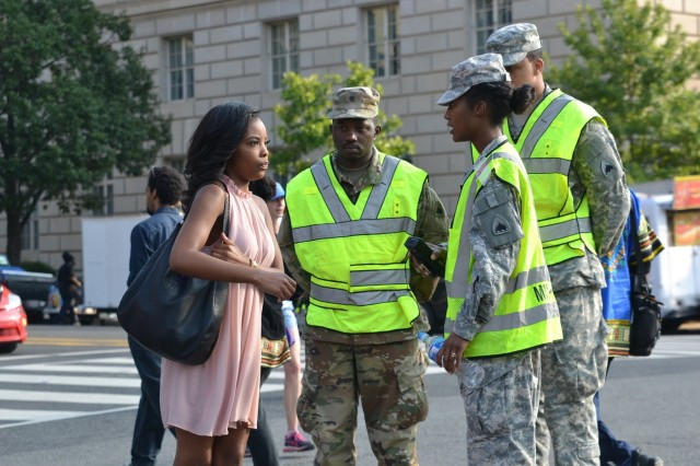 District of Columbia National Guard Soldiers assist a visitor on the National Mall, Washington, D.C., Sept. 24. Nearly 40,000 spectators were in the area for the grand opening of the National Museum of African American History and Culture. Capital Guardians provided support to local transportation and federal law enforcement agencies during the event.