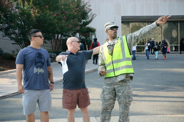 Spc. Timothy Robinson, 547th Transportation Company, gives directions to visitors attending the opening of the National Museum of African American History and Culture in Washington, D.C., Sept. 24. . Nearly 100 Citizen Soldiers and Airmen from the District of Columbia National Guard provided support to local transportation and federal law enforcement agencies throughout the day's festivities.