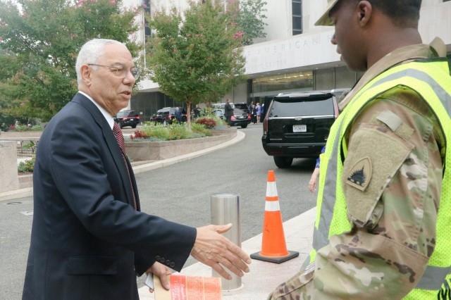 Former Secretary of State Colin Powell shakes hands with Pvt. Devin Carter, 547th Transportation Company, thanking him for his service. Citizen Soldiers and Airmen from the District of Columbia National Guard provided support to local transportation and federal law enforcement agencies during the grand opening of the National Museum of African American History and Culture in Washington, D.C. Sept. 24.