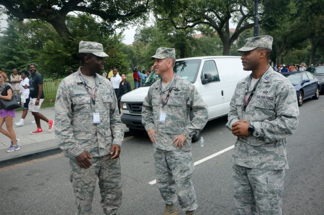 Brig. Gen. Jeffrey Bozard (center), commander of the 113th Wing and Capt. Earl Taylor (right), 113th Wing, ask Airman 1st Class Leo Bowman (left), of the 113th Wing about manning his respective station. Citizen Soldiers and Airmen from the District of Columbia National Guard provided support to local transportation and federal law enforcement agencies during the grand opening of the National Museum of African American History and Culture in Washington, D.C. Sept. 24.