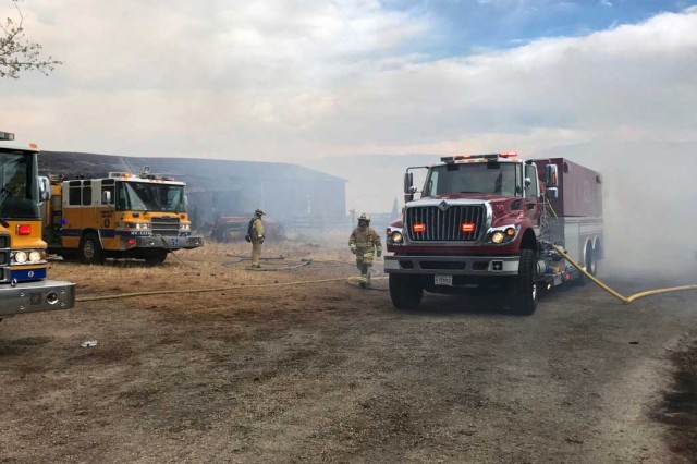 A Nevada Air National Guard fire tender re-supplies fire engines from multiple governmental agencies during the Little Valley Fire that burned 22 homes Friday.