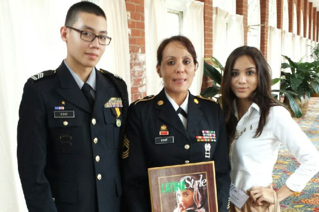 Master Sgt. Patricia Font poses with her National Latino Style Distinguished Service Award while flanked by her daughter, Gabriella, and son Alexander, an ROTC cadet at Texas A&M.