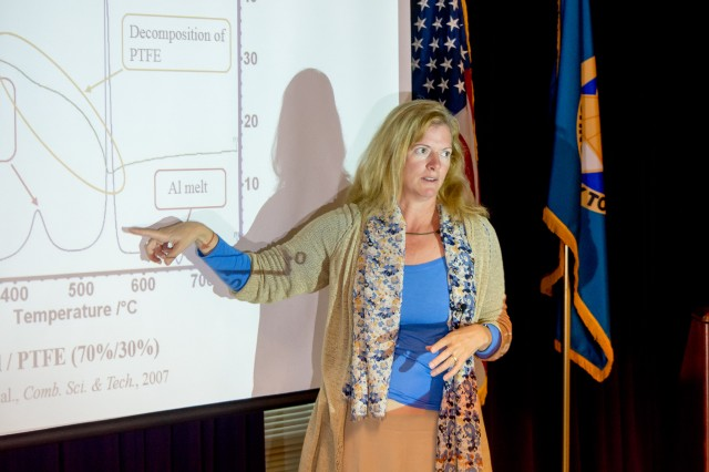 Dr. Michelle L. Pantoya, a Texas Tech University mechanical engineering professor, discusses her team's findings with U.S. Army Research Laboratory scientists at Aberdeen Proving Ground, Maryland, Oct. 14, 2016.