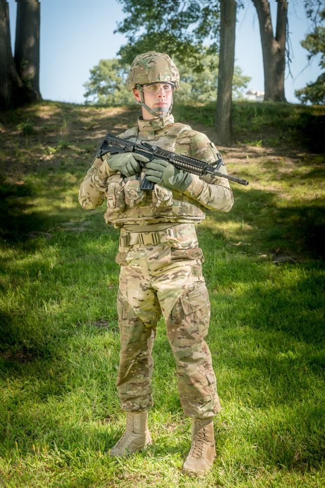 Soldier wearing blast debris protective harness