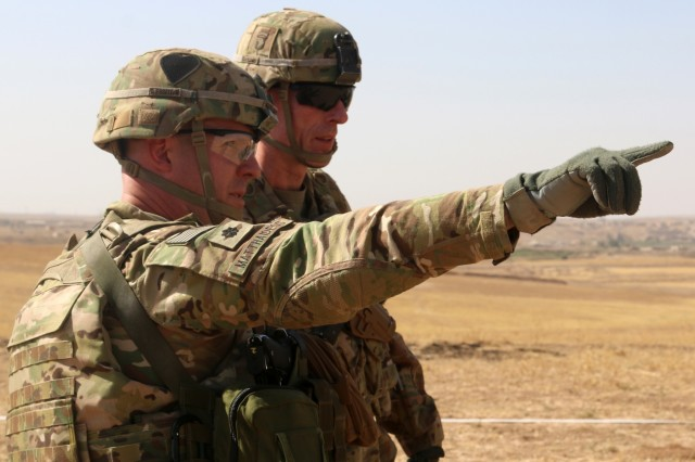 U.S. Army Lt. Col. Ed Matthaidess, commander, left, Task Force Falcon, outlines areas of an Iraqi security forces tactical assembly area to U.S. Army Maj. Gen. Gary J. Volesky, commander, Combined Joint Forces Land Component Command - Operation Inherent Resolve, in northern Iraq, prior to the start of the Mosul offensive, Oct. 10, 2016. The TAAs are where ISF assembled prior to moving toward Mosul. A Coalition of regional and international nations have joined together to defeat the Islamic State or Iraq and the Levant and the threat they pose to Iraq, Syria, the region and the wider international community. (U.S. Army photo by Sgt. 1st Class R.W. Lemmons IV)