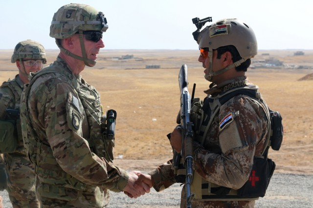 U.S. Army Maj. Gen. Gary J. Volesky, left, commander, Combined Joint Forces Land Component Command - Operation Inherent Resolve, visits with an Iraqi soldier at a tactical assembly area in northern Iraq, Iraq, prior to the start of the Mosul offensive, Oct. 10, 2016. The TAAs are where ISF assembled prior to making their push toward Mosul. A Coalition of regional and international nations have joined together to defeat the Islamic State of Iraq and the Levant and the threat they pose to Iraq, Syria, the region and the wider international community. (U.S. Army photo by Sgt. 1st Class R.W. Lemmons IV)