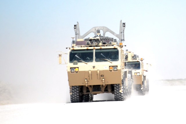 "At Fort Bliss, Texas, Oct. 14, 2016, one tactical vehicle, with a driver, is followed automatically by another, without input from the passenger behind the wheel.  The ""leader-follower"" vehicle concept is being evaluated during the Army Warfighter Assessment 17.1 at Fort Bliss.  In practice, multiple vehicles in a convoy could be controlled by only one vehicle, the lead vehicle, while the follow-on vehicles remain driverless. Without the need for those additional drivers, there would be fewer Soldiers involved in the convoy and less risk of loss of life in the event the convoy is attacked."