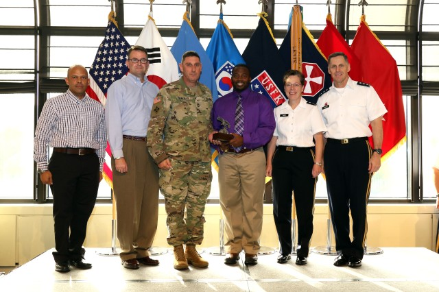 One of several Eighth Army units recognized Sept. 30 at U.S. Army Garrison Yongsan in Seoul during the 2015 Combined Logistics Excellence Awards poses for a photo with Eighth Army Commander Lt. Gen. Thomas Vandal and Eighth Army Deputy Commanding General for Sustainment Maj. Gen. Tammy Smith. The logistics competition evaluates units based on their effective use of maintenance and supply resources, innovation, readiness, safety, quality control, and several other criteria.