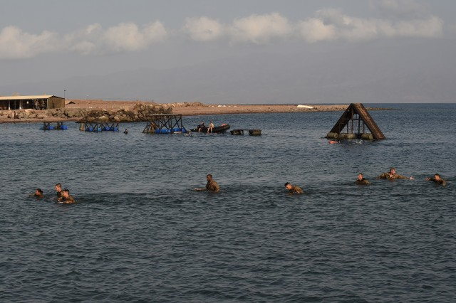 ARTA PLAGE, Djibouti -- U.S. Army Soldiers from the 1st Battalion, 124th Infantry Regiment, assigned to Combined Joint Task Force-Horn of Africa, complete a water obstacle course as part of the French Marines Desert Survival Course, Oct. 10, 2016, at Arta Plage, Djibouti. Approximately 46 U.S. Army Soldiers with French Marines completed several tasks during the survival course, including desert operations, combat lifesaving skills, weapons training, survival cooking, how to decontaminate water, and water and mountain obstacle courses.