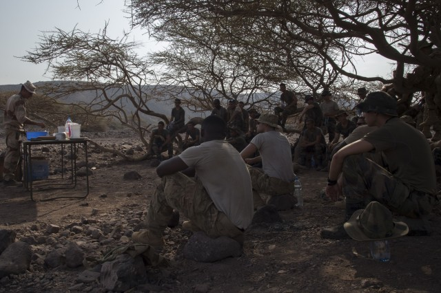 Members of the U.S. Army Florida National Guard, 1st Battalion, 124th Infantry Regiment, watch a French Marine make dough as part of survival skills training, Sept. 26, 2016, at Arta Plage, Djibouti. Approximately 46 U.S. Army Soldiers with Task Force Hurricane, assigned to Combined Joint Task Force-Horn of Africa, along with French Marines completed the French Marine Desert Survival Course.