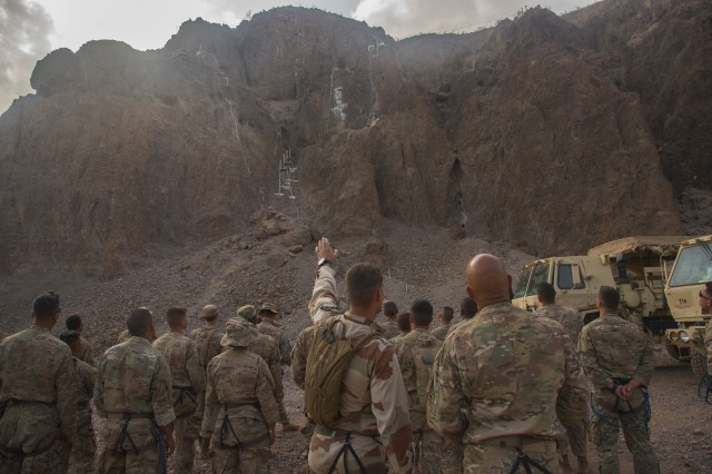 U.S. Army Soldiers from the 1st Battalion, 124th Infantry Regiment, assigned to Combined Joint Task Force-Horn of Africa, begin the the mountain obstacle course portion of the French Marines Desert Survival Course, Oct. 10, 2016, at Arta Plage, Djibouti. Approximately 46 U.S. Army Soldiers with French Marines completed several tasks during the survival course, including desert operations, combat lifesaving skills, weapons training, survival cooking, how to decontaminate water, and water and mountain obstacle courses.