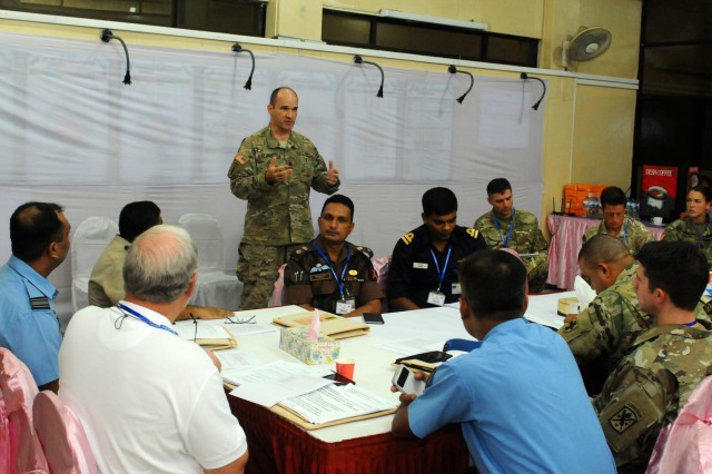 Lt. Col. David Downing (standing), Civil Military Operations Officer, US Army Pacific, speaks to a working group during Pacific Resilience Disaster Response Exercise & Exchange in Dhaka, Bangladesh, Oct. 4. The seven-day event brought together more than 250 participants from China, Maldives, Myanmar, Nepal, Sri Lanka, the United Kingdom, the United Nations and the United States, as well as dozens of governmental and non-governmental and international organizations. (U.S. Army photo by Staff Sgt. Chris McCullough)