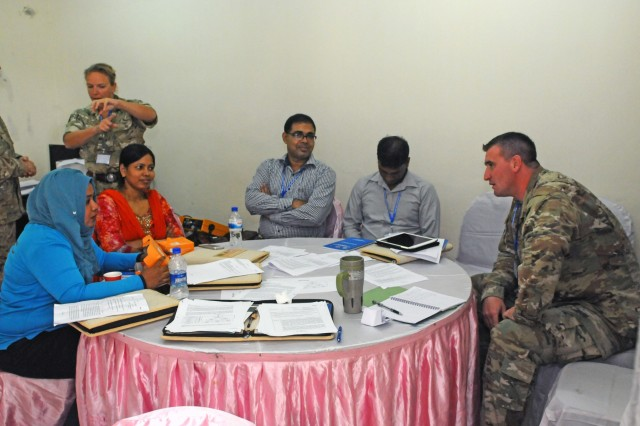 Chief Warrant Officer 3 Willis Allen, 8th Theater Sustainment Command speaks to a working group during Pacific Resilience Disaster Response Exercise & Exchange in Dhaka, Bangladesh, Oct. 5. The seven-day event brought together more than 250 participants from China, Maldives, Myanmar, Nepal, Sri Lanka, the United Kingdom, the United Nations and the United States, as well as dozens of governmental and non-governmental and international organizations. (U.S. Army photo by Staff Sgt. Chris McCullough)