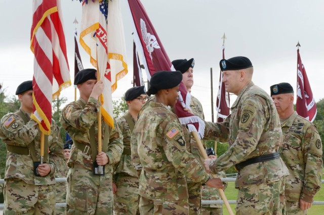 Command Sgt. Maj. Tabitha Gavia receives the Regional Health Command - Central colors from Maj. Gen. Thomas R Tempel Jr, RHC-C commanding general, during the change of responsibility ceremony at Joint Base San Antonio - Fort Sam Houston Oct. 7.