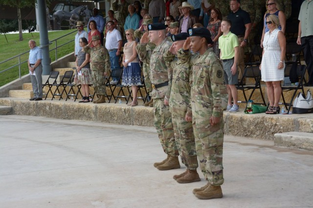 (from left) Maj. Gen. Thomas R Tempel Jr, Regional Health Command - Central commanding general; Command Sgt. Maj. Jayme Johnson, outgoing command sergeant major, and Command Sgt. Maj. Tabitha Gavia, incoming sergeant major, salute during the playing of the national anthem at the change of responsibility ceremony Oct. 7 at Joint Base San Antonio - Fort Sam Houston.