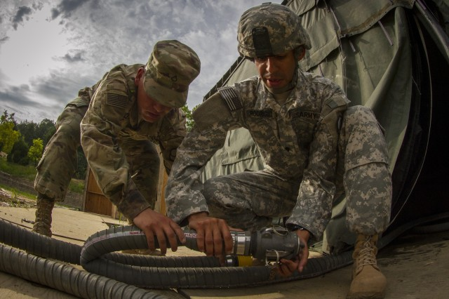 Pfc. Andrew Skalecki and Spc. Jose Rodriquez, water treatment specialists with the 339th Quartermaster Company, resupply more than 500 U.S. and Canadian Soldiers staying in a tent village at Yongin, South Korea, on Aug. 25, 2016.