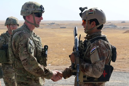 Maj. Gen. Gary J. Volesky, left, commander, Combined Joint Forces Land Component Command -- Operation Inherent Resolve, visits with an Iraqi soldier at a tactical assembly area in northern Iraq, prior to the start of the Mosul offensive, Oct. 10, 2016. The TAAs are where ISF assembled prior to making their push toward Mosul. A Coalition of regional and international nations have joined together to defeat the Islamic State of Iraq and the Levant and the threat they pose to Iraq, Syria, the region and the wider international community.