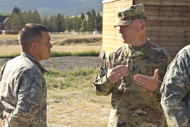 U.S. Army Reserve Command, Command Sergeant Major, Command Sgt. Maj. James P. Wills speaks with Spc. Michael S. Orozco, USARC 2016 Best Warrior winner in the Soldier category after an obstacle course training at Fort Harrison, MT, August 5, 2016. The USARC BWC winners from the noncommissioned officer and Soldier category went through rigorous training, leading up to their appearance at Fort A.P. Hill later this year for the Department of Army BWC. (U.S. Army Reserve photo by Brian Godette, USARC Public Affairs/Released).