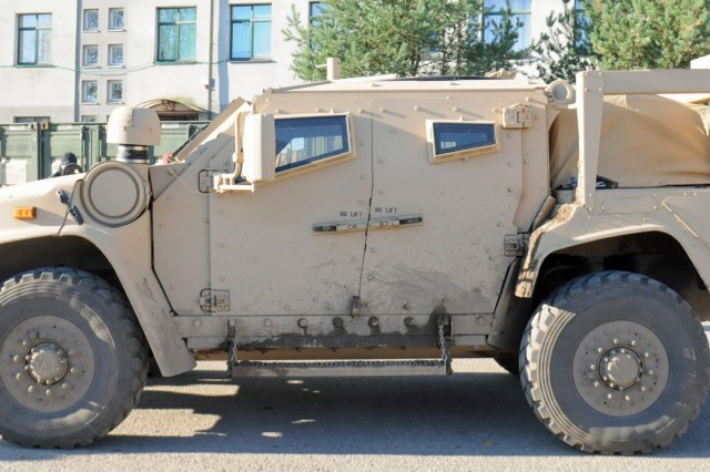 RUKLA, Lithuania - A Light Combat All-Terrain Vehicle (L-ATV) sits in front of the barracks here, Oct. 18. The L-ATV will replace the HMMWV, as the Army's all-terrain troop-carrying vehicle. In 2019, airborne units, starting with the 82nd Airborne Division and following with the 173nd Infantry Brigade Combat (Airborne), will be issued these vehicles, which are light enough to be transported by helicopter. Once the airborne units have been issued the vehicles, the rest of the Army will receive them.