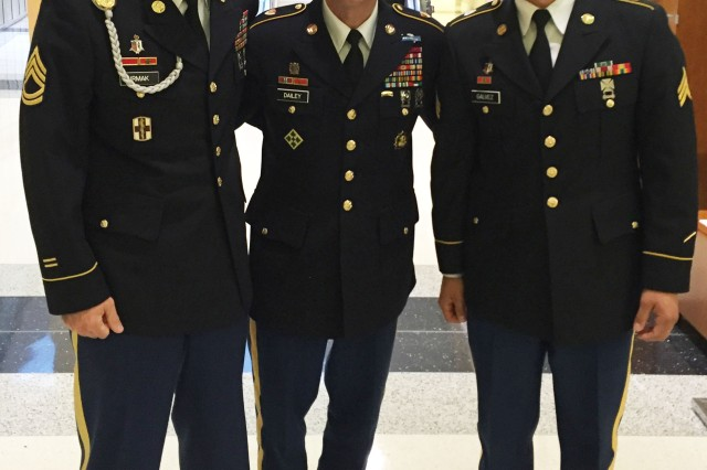 U.S. Army Sgt. 1st Class Ilker Irmak (left) and Sgt. Victor Galvez (right), both  assigned to U.S. Army Medical Command, pose with Sgt. Maj. of the Army Daniel Dailey (middle) during the Association of the United States symposium in Washington D.C. Oct. 3-5. During the event the winners of the U.S. Army Best Warrior Competition were announced. Irmak took the third place title. (Courtesy Photo)