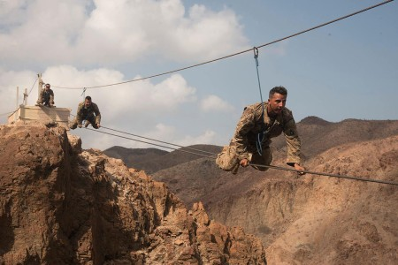 Soldiers from 1st Battalion, 124th Infantry Regiment, assigned to Combined Joint Task Force-Horn of Africa, make their way across a portion of the mountain obstacle course, as part of the final day of the French Marines Desert Survival Course, Oct. 10, 2016, at Arta Plage, Djibouti. Approximately 46 U.S. Army Soldiers with French Marines completed several tasks during the survival course, including desert operations, combat lifesaving skills, weapons training, survival cooking, how to decontaminate water, and water and mountain obstacle courses.
