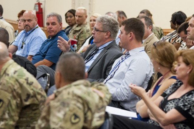 Army personnel ask questions while attending the U.S. Army Sustainment Command's senior-level Commanding General's Leadership Professional Development training event in Heritage Hall at Rock Island Arsenal, Illinois, Oct. 17.