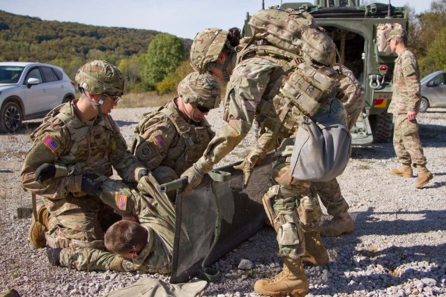 "SLUNJ, Croatia -- (L-R) Sgt. Emilio Saenz, Sgt. Sean Dowty and Pvt. Kesy Delilo, all medics assigned to Iron Troop, 3rd Squadron, 2nd Cavalry Regiment, U.S. Army, place a simulated casualty on a stretcher during Puma 16 Oct 13, 2016 at Military Training Area Eugen Kvaternik. The medics practiced evacuating a simulated casualty in a Stryker Medical Evacuation Vehicle from the point of injury at the farthest location in the training area to the ambulance exchange point. Iron Troop is training in Croatian with 2nd Mechanized Battalion ""Puma"" of the Guard Armored-Mechanized Brigade, Croatian Land Forces. (Photo by: Staff Sgt. Jennifer Bunn, 2d Cavalry Regiment Public Affairs)"