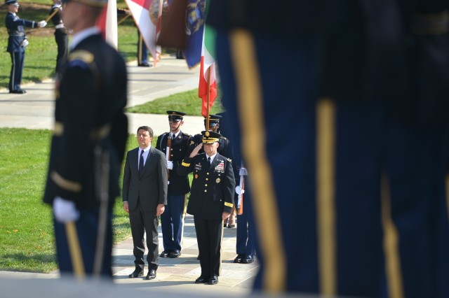 Prime Minister of Italy, His Excellency Matteo Renzi, and Maj. Gen. Bradley A. Becker, commanding general, Joint Force Headquarters-National Capital Region and the U.S. Army Military District of Washington render honors at the Tomb of the Unknown Soldier in Arlington National Cemetery Oct. 19, 2016, prior to laying a wreath at the Tomb in honor of fallen service members.