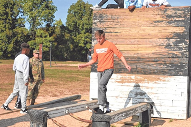 Waynesville High School football players negotiate and obstacle on Fort Leonard Wood Oct. 6.