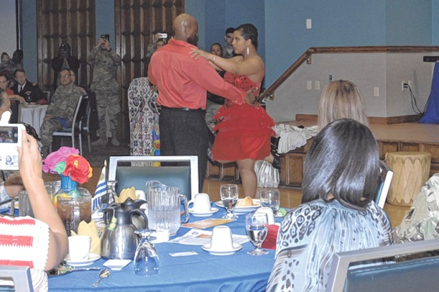 Sgt. 1st Class Benson Thomas and 1st Sgt. Daphne Thomas perform Latin dance at the Maneuver Support Center of Excellence and Fort Leonard Wood Hispanic Heritage Month Observance, hosted by the Noncommissioned Officers Academy, Oct. 12 at Pershing Community Center.
