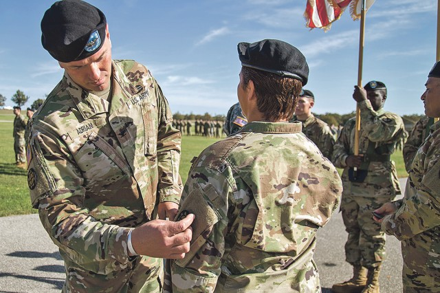 Col. Anthony Adrian, Missouri National Guard's 35th Engineer Brigade commander, places the brigade's patch on the shoulder of Lt. Col. Jaqueline Reini, 5th Engineer Battalion commander, during a patching ceremony to signify the beginning of the units' partnership through the Associated Units Pilot Program Monday at Fort Leonard Wood. The program will allow the two units to work together before deploying to build readiness and train on their shared mission.