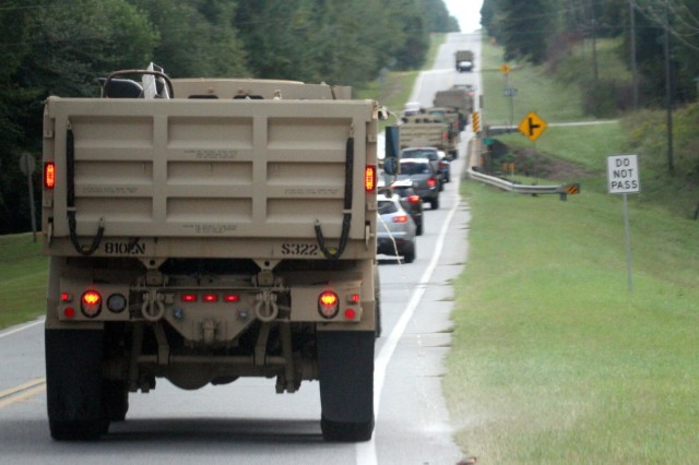 A column of Georgia Army National Guard vehicles of the Swainsboro-based 810th Engineer Company heads south to Glynn County to assist Hurricane Matthew response operations.