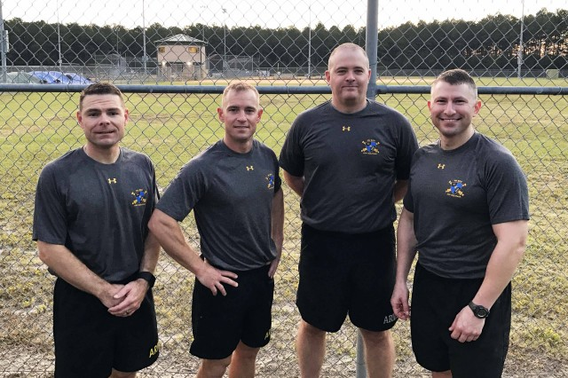 Four of the members of the 4th Battlefield Coordination Detachment Army 10 Miler Team (left to right) Sgt. First Class Anthony Bush, Maj. James Horn, Capt. Christopher Shaffer, and Maj. Noah Cooper pose for a photo at Shaw Air Force Base, S.C., recently. (Courtesy photo)