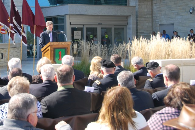 Governor of Kansas Sam Brownback speaks to a crowd at the ribbon cutting ceremony of the new Irwin Army Community Hospital Oct. 12. Compared to the old hospital, the new one has about 47 percent more space. It is 550,669 square feet, while the old hospital is 380,000 square feet.