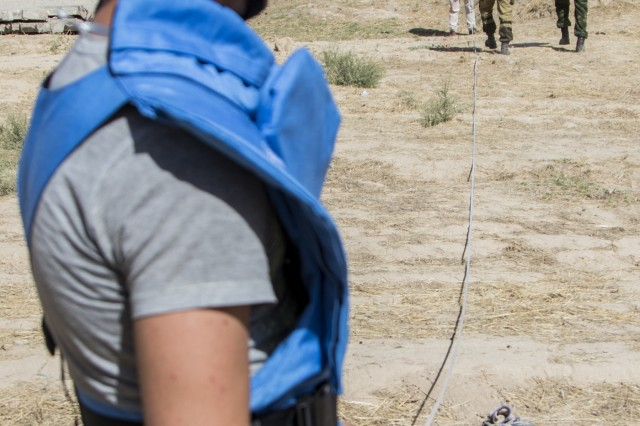 Students from Central and Southeast Asia, participating in the Humanitarian Mine Actiontraining course, prepare their equipment to conduct Improvised Explosive Device explosive-effects training with explosive material Sept. 29, 2016 in Tajikistan. U.S. Army Soldiers, in support of U.S. Army Central, certified 39 participants from Tajikistan, Kazakhstan, Kyrgyzstan, Afghanistan and Armenia on explosive hazard mitigation in accordance with the International Mine Action Standard.