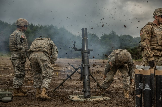 U.S. Army mortar teams with Headquarters Company, 2nd Battalion, 27th Infantry Regiment, 3rd Brigade Combat Team, 25th Infantry Division, fire the M120 Battalion Mortar System at Aibano Training Area, Japan, Sept. 13, 2016 as part of Orient Shield 2016. Orient Shield is an annual bilateral training exercise held in Japan. (U.S. Photo by Spc. Patrick Kirby/released)