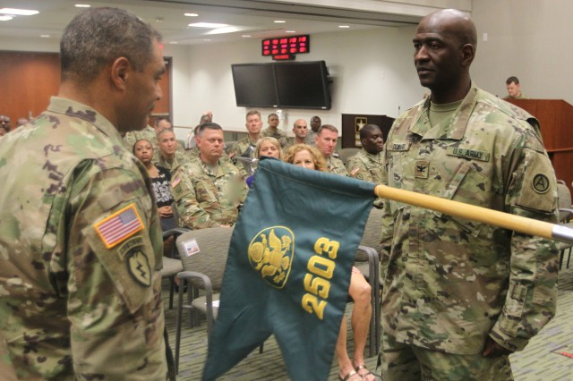 Lt. Gen. Michael Garrett (left), U.S. Army Central commanding general, and Col. Oscar Doward Jr.(right), commander of 2503rd Digital Liaison Detachment, uncase the 2503rd DLD colors during an activation and assumption of command ceremony Oct. 21, 2016, at Patton Hall on Shaw Air Force Base, S.C. (U.S. Army photo by Sgt. Victor Everhart Jr.)