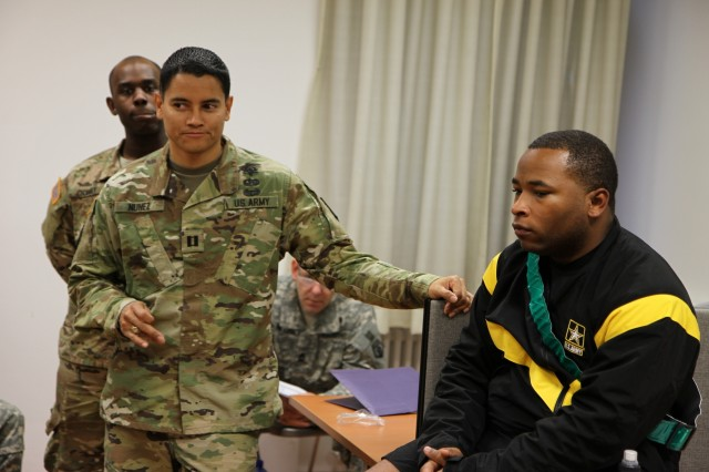 "KAISERSLATERN, Germany - Army Capt. Sway Nunez, left, of the 254th Medical Detachment, speaks during a ""train the trainer"" lesson in the science of sleep to Army Reserve medical professionals of the Medical Support Unit of the 7th Mission Support Command in a briefing conducted at Daenner Kaserne on Oct. 22, 2016."