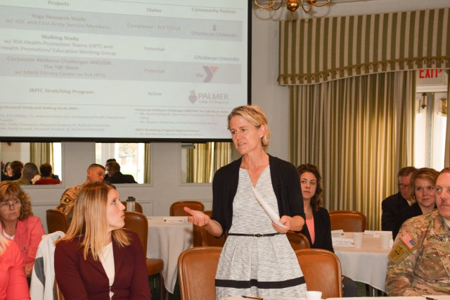 Dr. Erin Phillips of St. Ambrose University, Davenport, Iowa, presents information on the school's wellness programs and how they can support Rock Island Arsenal during the quarterly meeting of the arsenal's Community Health Promotion Council, held Oct. 20.