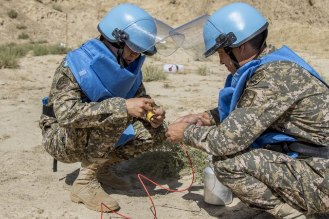 Students from Central and Southeast Asia, participating in the Humanitarian Mine Action training course, prepare their equipment to conduct Improvised Explosive Device explosive-effects training with explosive material Sept. 29, 2016, in Tajikistan. U.S. Army Soldiers, in support of U.S. Army Central, certified 39 participants from Tajikistan, Kazakhstan, Kyrgyzstan, Afghanistan and Armenia on explosive hazard mitigation in accordance with the International Mine Action Standard.