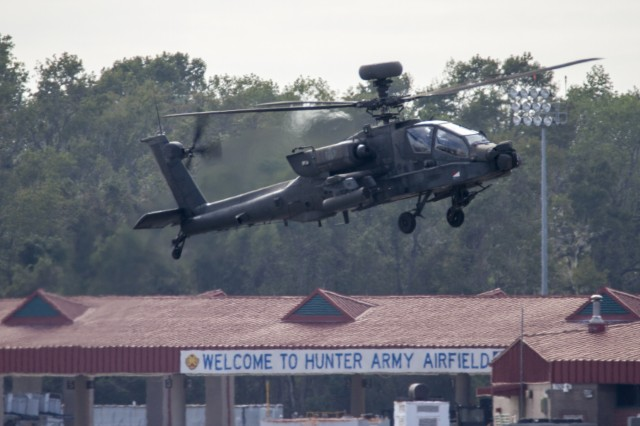 Aviators from 3rd Squadron, 17th Cavalry Regiment, 3rd Combat Aviation Brigade maneuver AH-64D Apache helicopters over Hunter Army Airfield during recovery efforts from Hurricane Matthew October 12. U.S. Army photo by Spc. Scott Lindblom