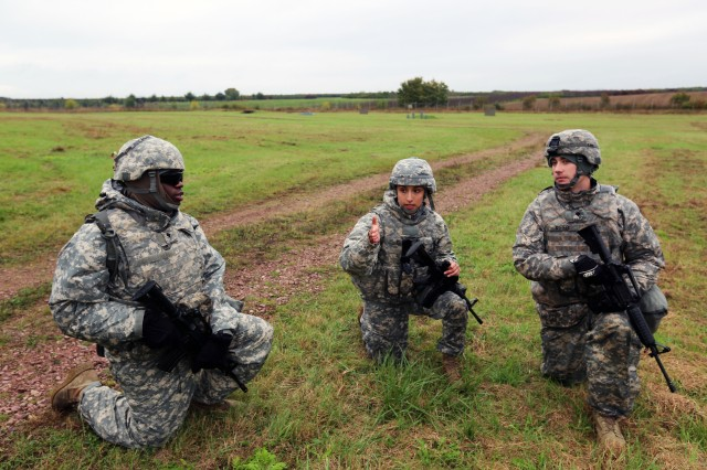 U.S. Army Spc. Marisa Patton (center) directs Spc. James Smith and Spc. Cody Reed to begin tactical movement during Commander's Prime Time Training (CPTT) Oct. 20, 2016 at the Wackernheim Training Area in Mainz, Germany. Team Signal Soldiers from 5th Signal Command (Theater), 2nd Signal Brigade and 102nd Signal Battalion participated in the CPTT focused on Warrior Tasks and Battle Drills and culminating in a squad-level situational training exercise.