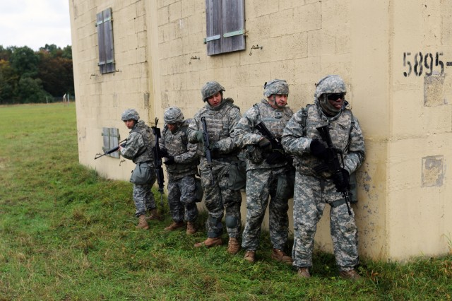 U.S. Army Soldiers stack against a wall before entering a building while conducting an urban operations drill during Commander's Prime Time Training (CPTT) Oct. 20, 2016 at the Wackernheim Training Area in Mainz, Germany. Team Signal Soldiers from 5th Signal Command (Theater), 2nd Signal Brigade and 102nd Signal Battalion participated in the CPTT focused on Warrior Tasks and Battle Drills and culminating in a squad-level situational training exercise.