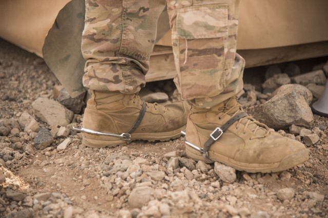 DJIBOUTI- Silver spurs adorn an U.S. Army Soldier's boots during a traditional Army spur ride event, Oct. 21, 2016, at a nearby airfield in Djibouti. Twenty-eight U.S. Army Soldiers and one Air Force Airman participated in the traditional Army event where they completed 10 tasks with various stress events before each task in approximately 19 hours. (U.S. Air Force photo by Staff Sgt. Tiffany DeNault)