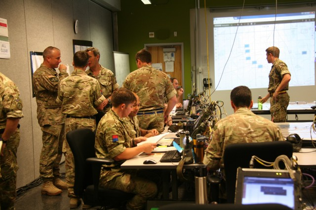Soldiers from the United Kingdom's 1 Armoured Infantry Brigade monitor the battlefield and leverage the coalition network to share critical data between partner nations.